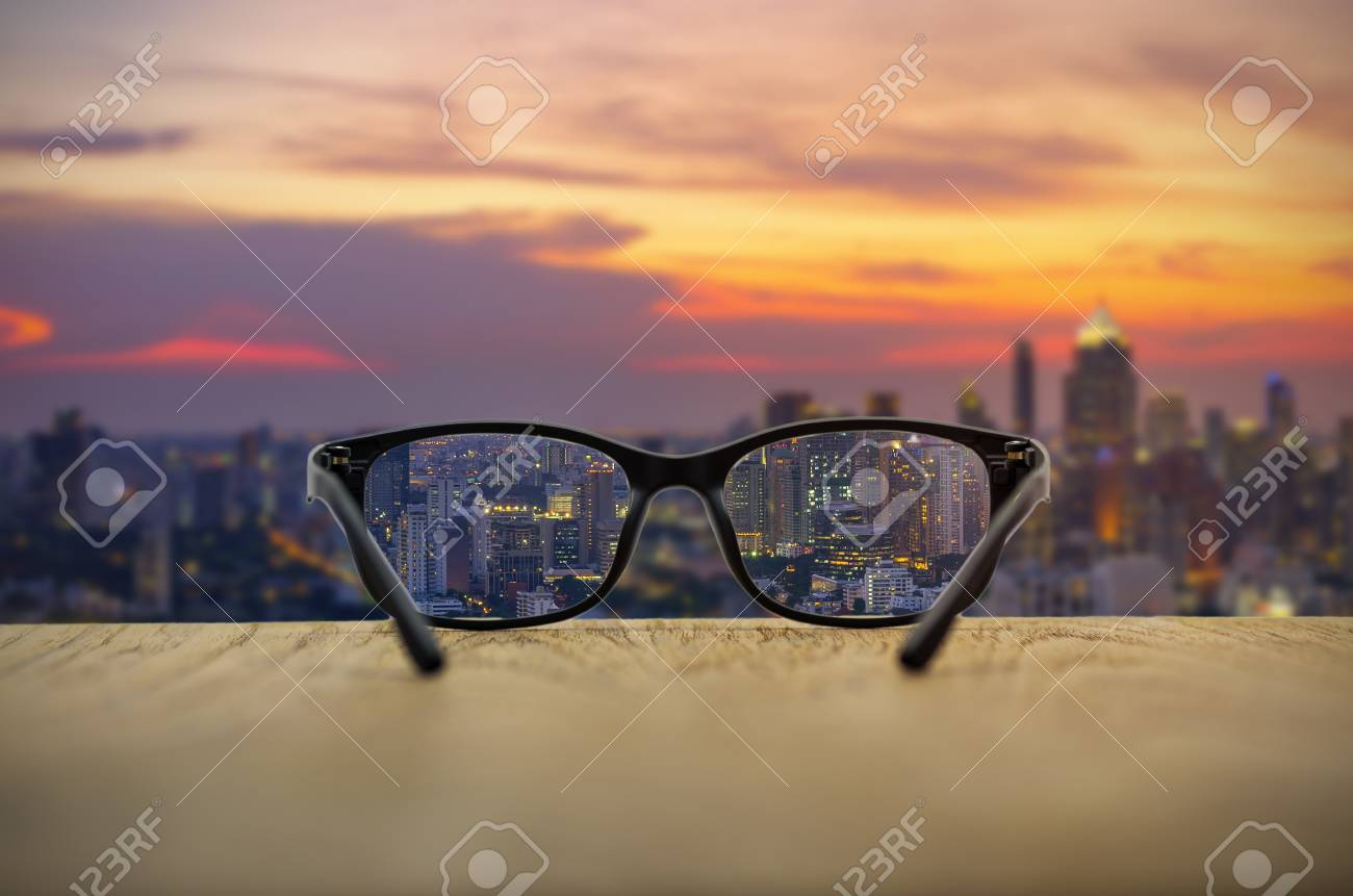 b7876677a3 Clear cityscape focused in glasses lenses with blurred cityscape  background. Stock Photo - 72390721