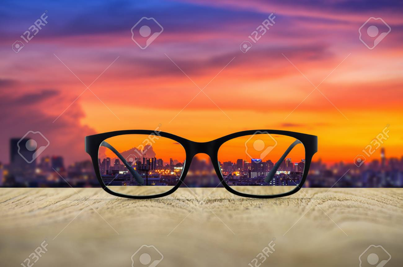 bb6a526787 Clear cityscape focused in glasses lenses with blurred cityscape  background. Stock Photo - 72434568
