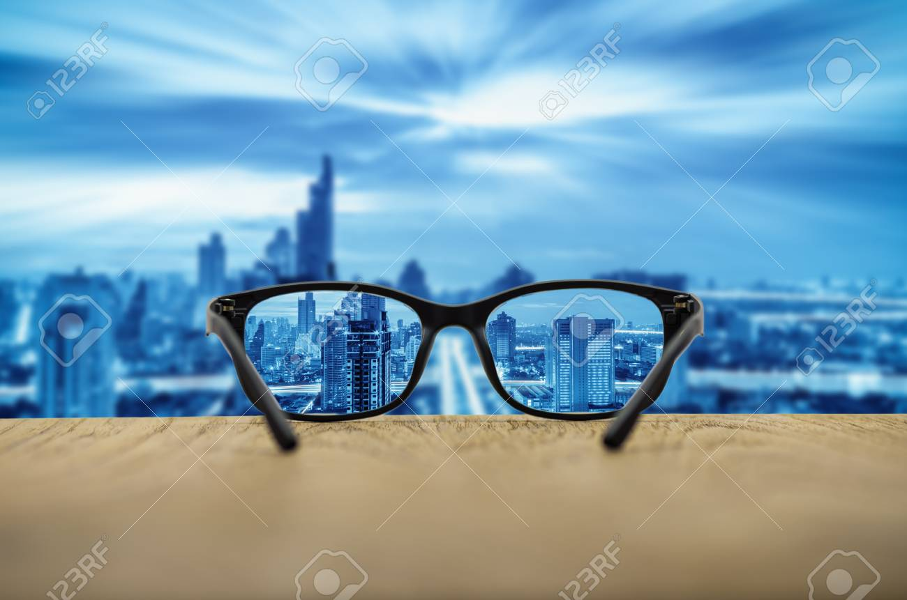 9118a09948 Clear cityscape focused in glasses lenses with blurred cityscape  background. Stock Photo - 78263030