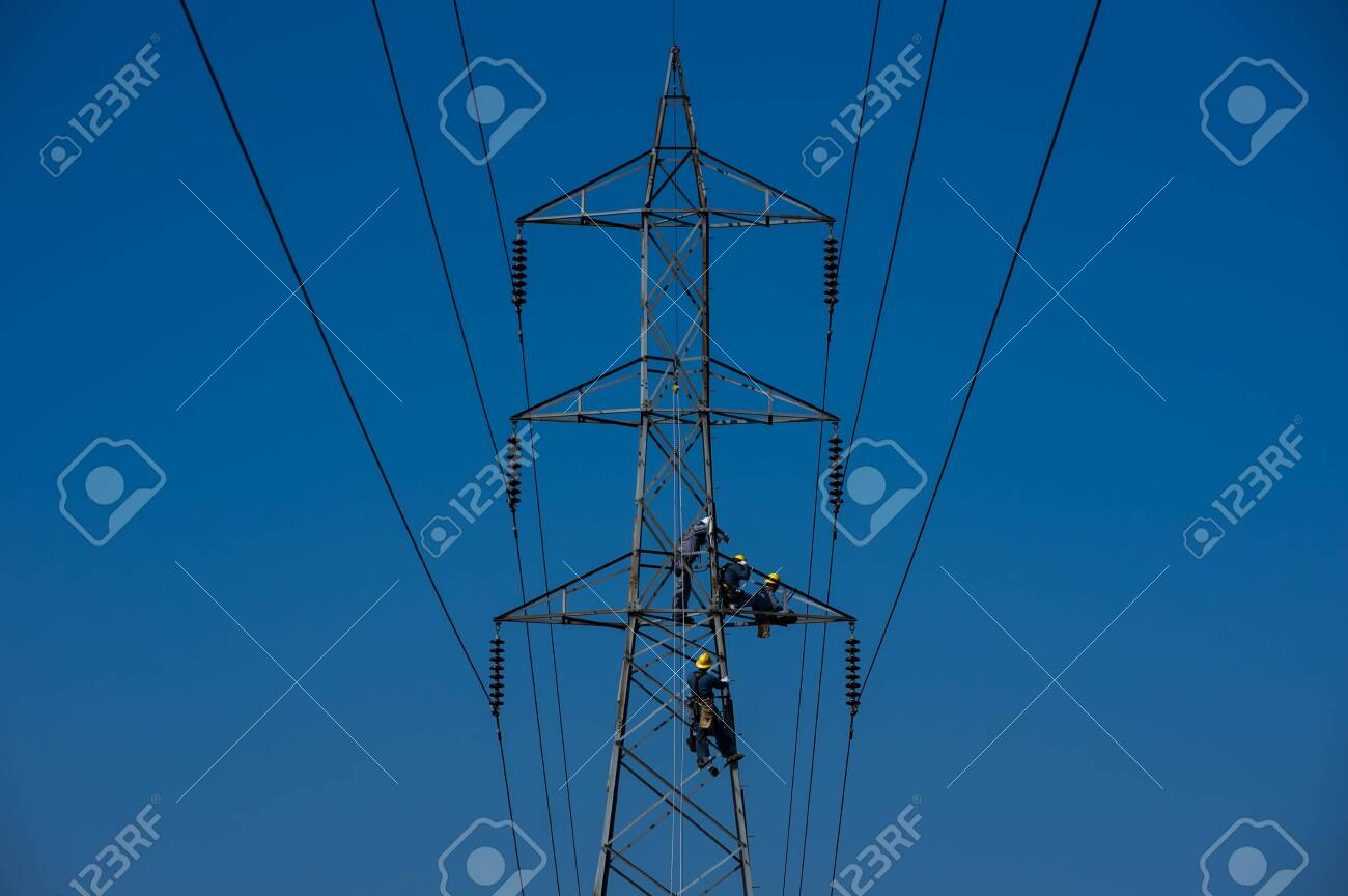 Maintenance staff on high voltage poles, Electrician or engineer works on power post and high voltage system for maintenance. High-power distribution system is damaged. - 124553833