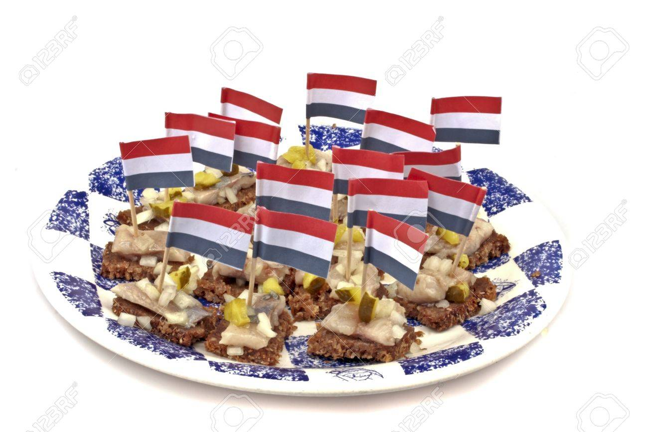 typical dutch rye bread with raw herring and onions with the