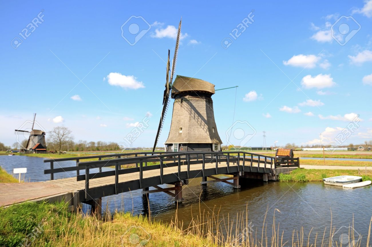 traditional windmills in dutch landscape in the netherlands stock
