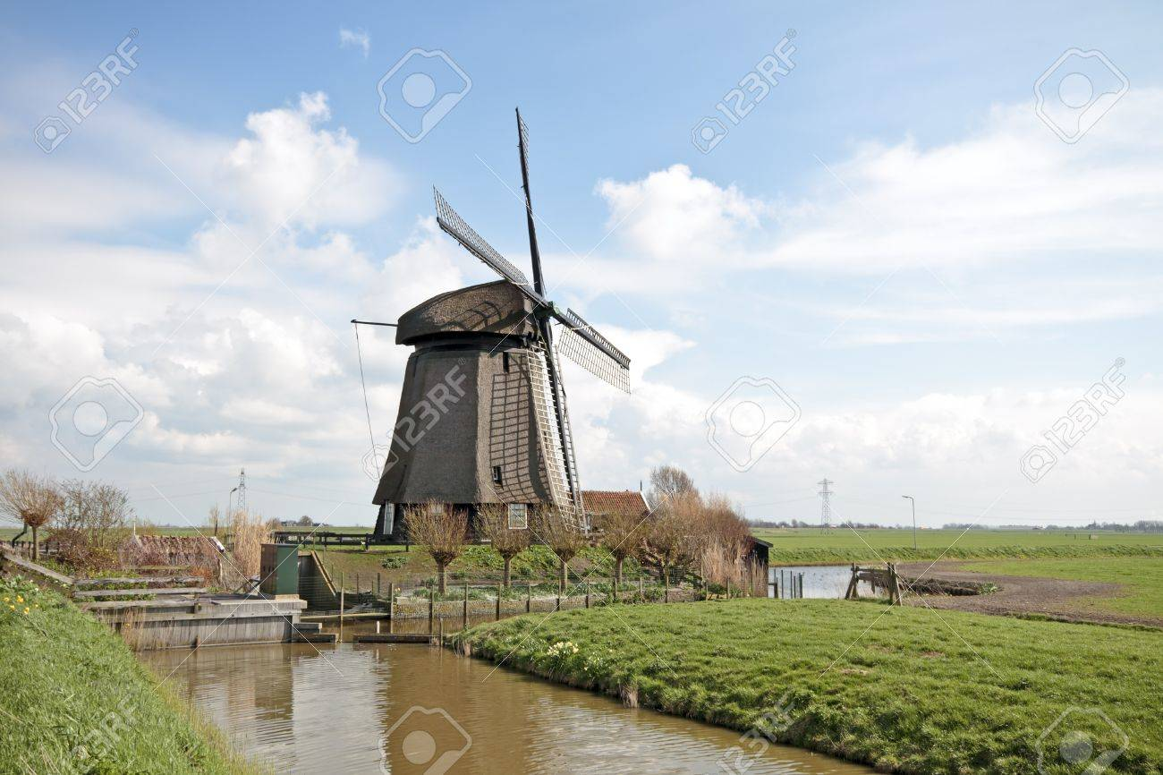 traditional windmill in dutch landscape in the netherlands stock