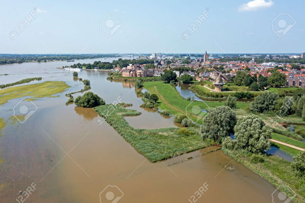 Aerial from the city Woudrichem at the river Merwede in the Netherlands in a flooded landscape - 172331717