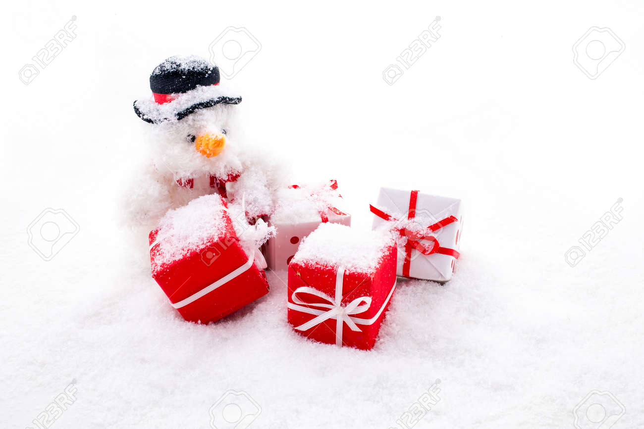 Christmas man with christmas presents in the snow - 172314413