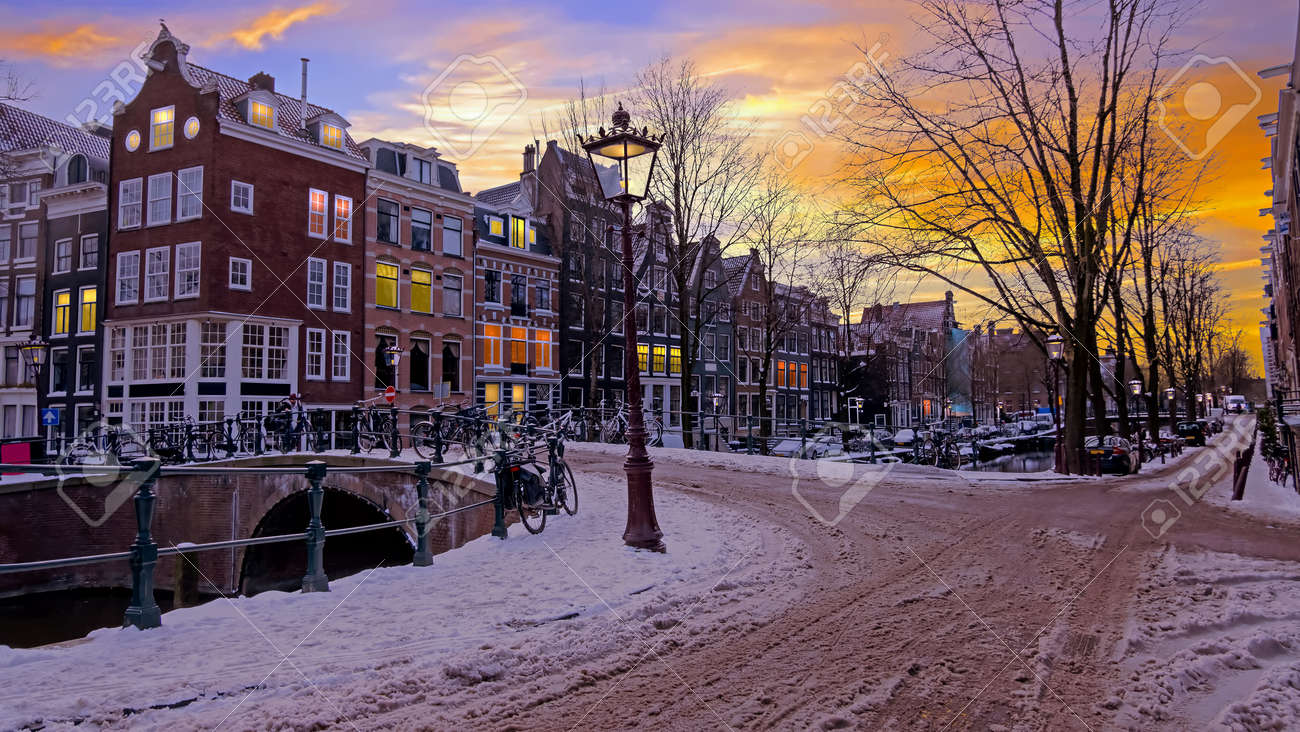 City scenic from a snowy Amsterdm in winter in the Netherlands at sunset - 172653789