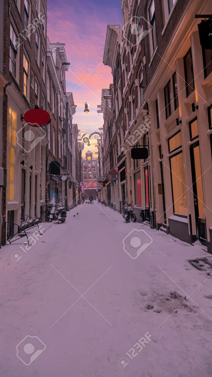 Snowy Red LIght District in winter in Amsterdam the Netherlands at sunset - 172653521