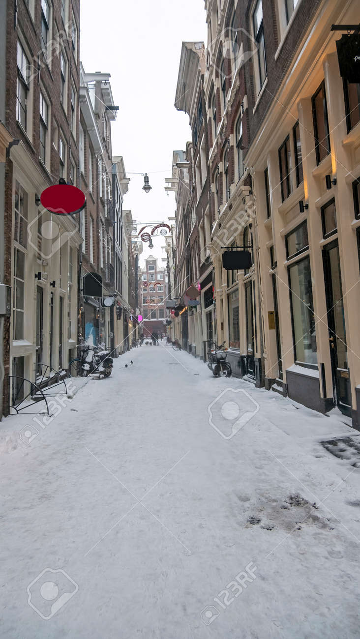 Snowy Red Light District in winter in Amsterdam the Netherlands - 172653799