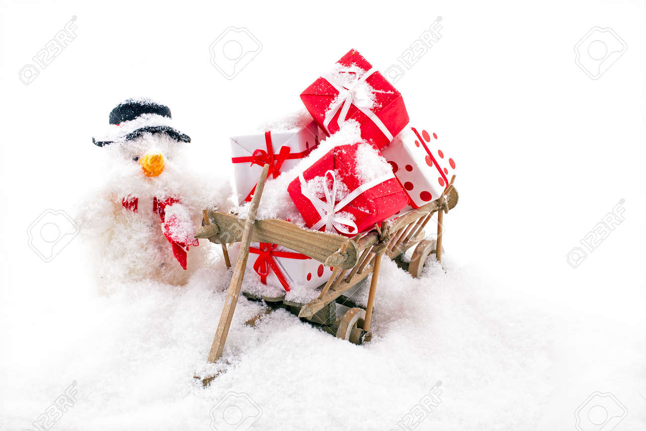 Christmas man with a wooden cart full of gifts in the snow - 172653861