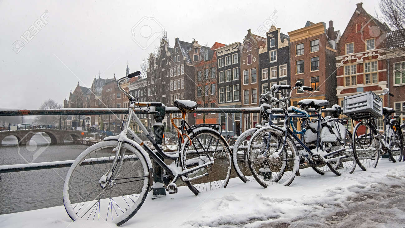 City scenic from a snowy Amsterdam in winter in the Netherlands - 172653910