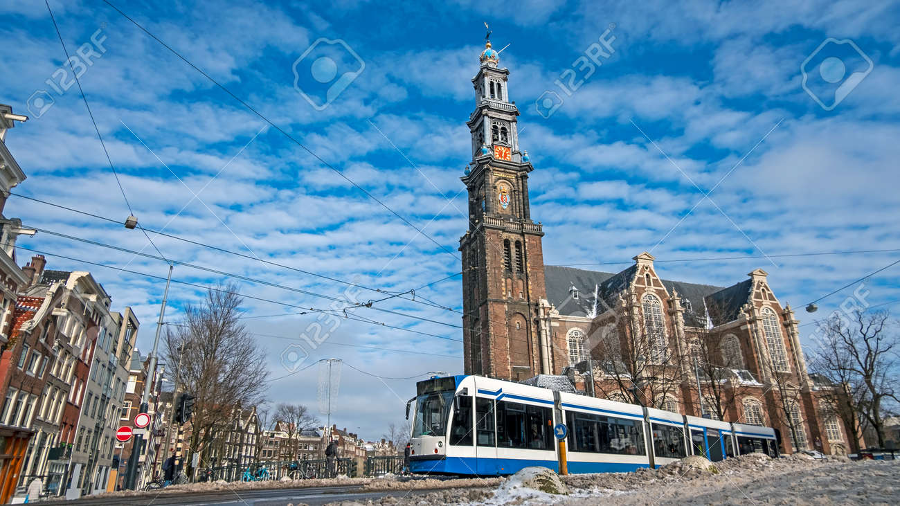City scenic from a snowy Amsterdam in winter near the Westerkerk in the Netherlands - 172654034
