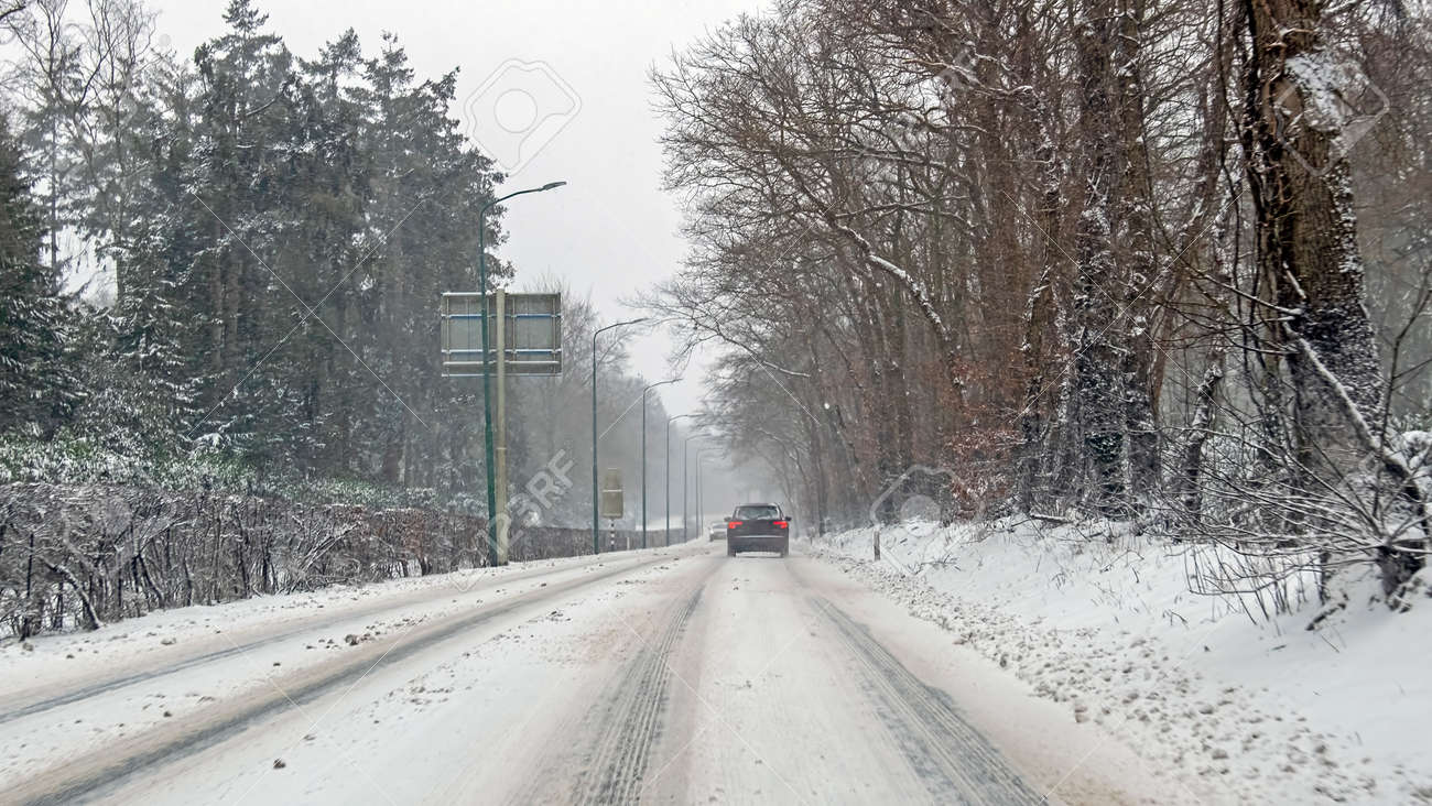 Driving in a snowstorm in the countryside from the Netherlands - 172654052