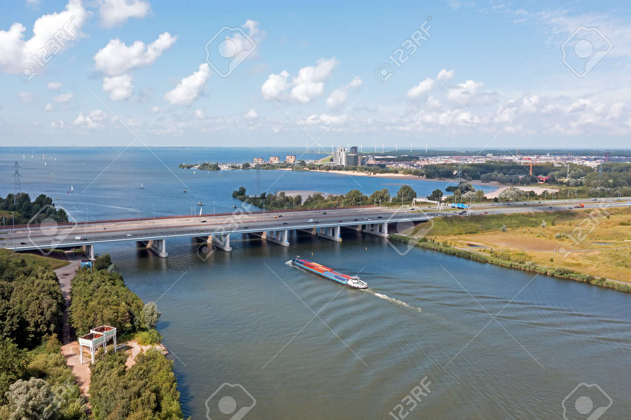 Aerial from the highway A6 at the Hollandsche Brug near Amsterdam at the IJsselmeer in the Netherlands - 173316887