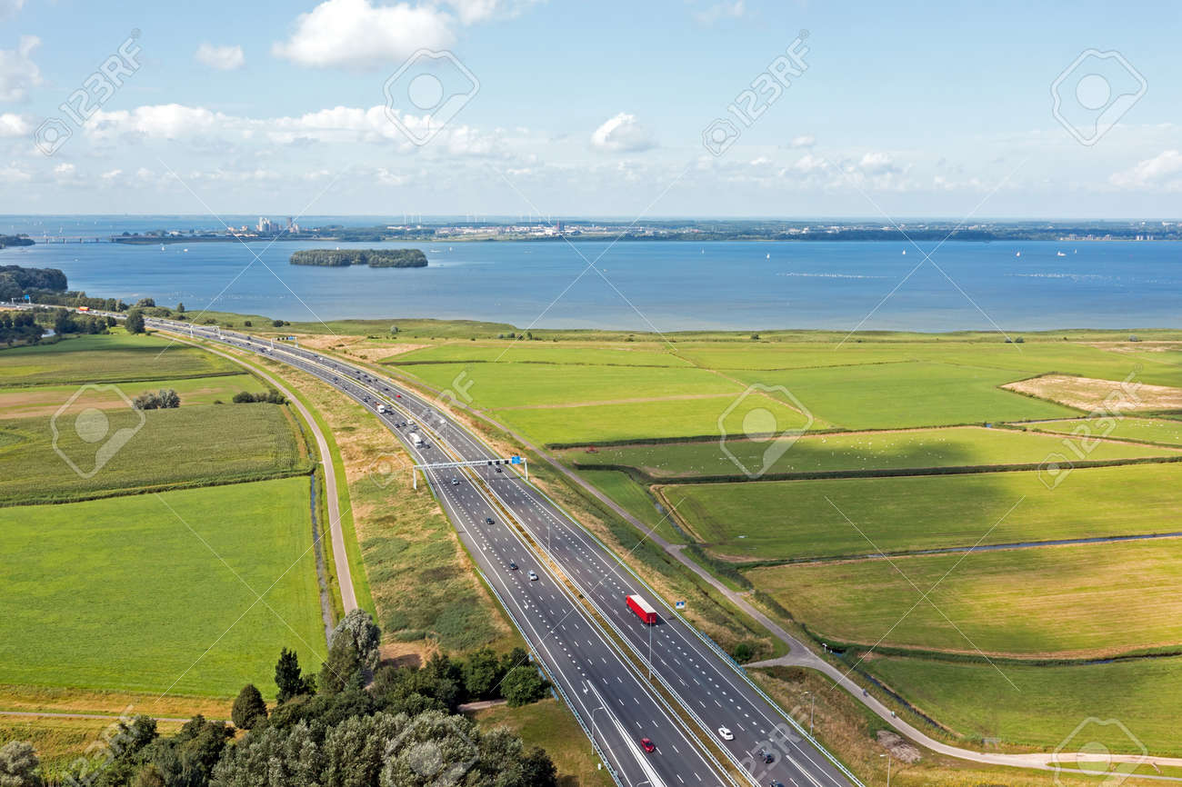 Aerial from the highway A1 near Amsterdam at the IJsselmeer in the Netherlands - 173318518