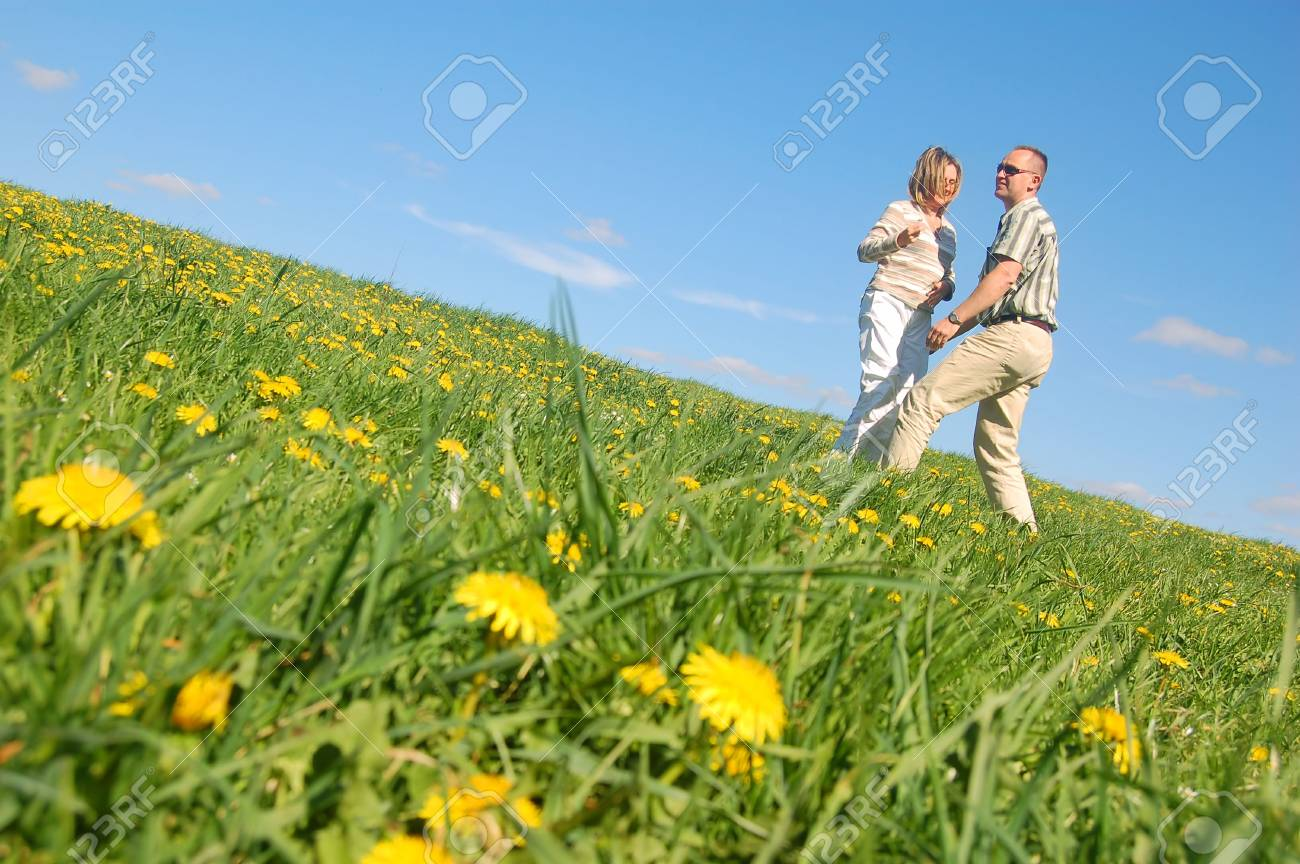 Couple in love having fun on spring meadow Stock Photo - 1105608