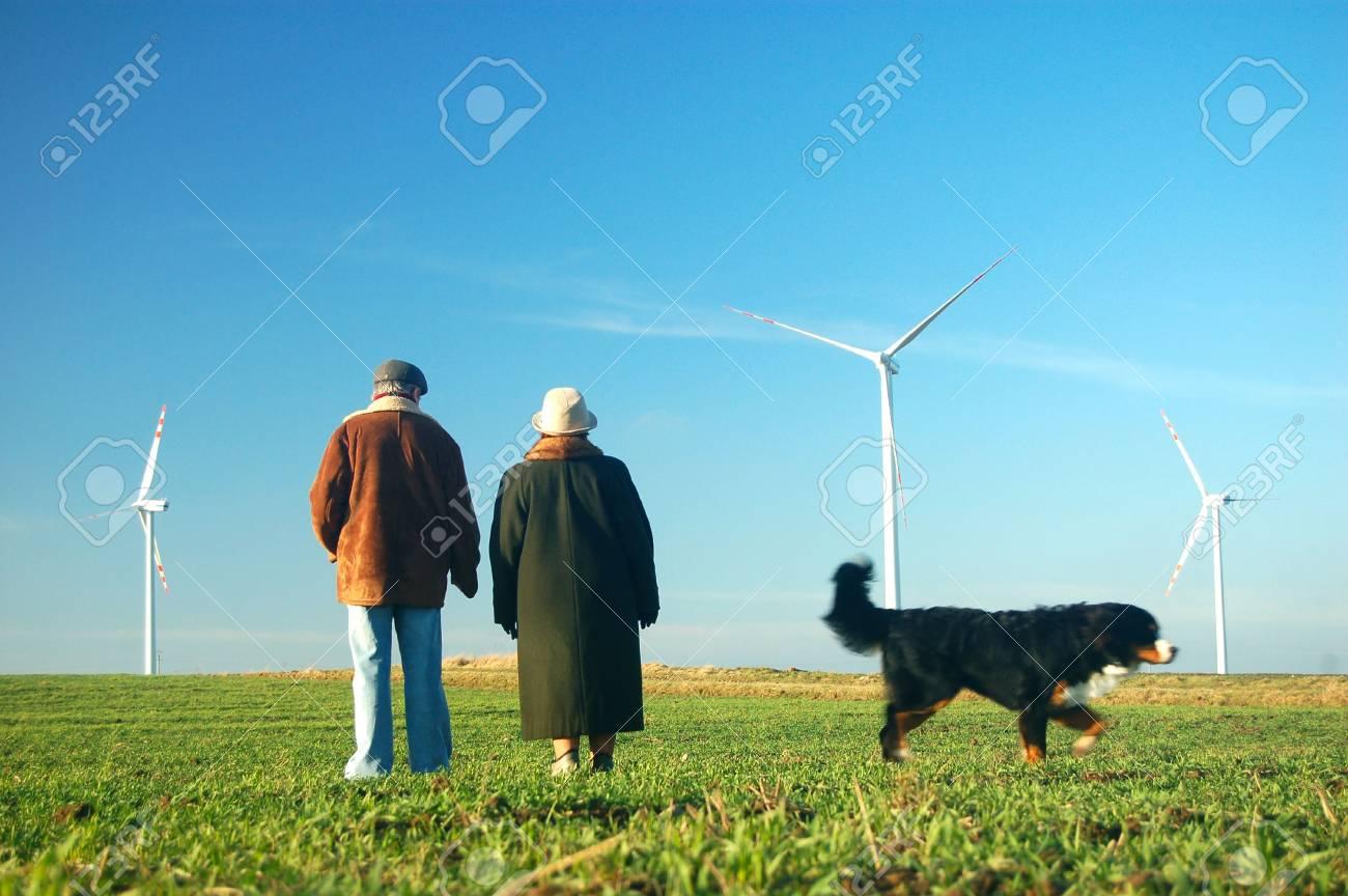 Seniors' couple looking on wind turbines Stock Photo - 3100375