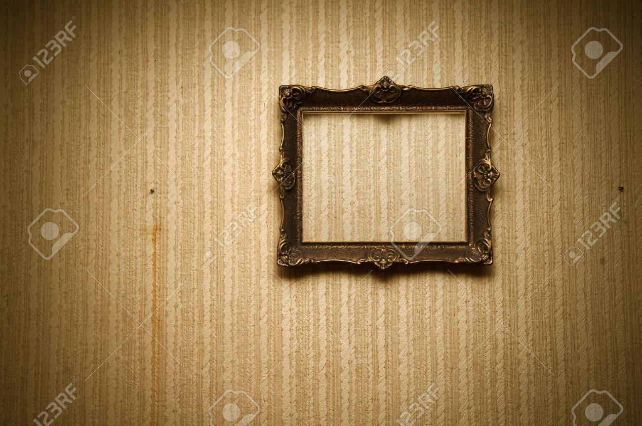 Old ornamented frame on retro grunge wall Stock Photo - 8579973
