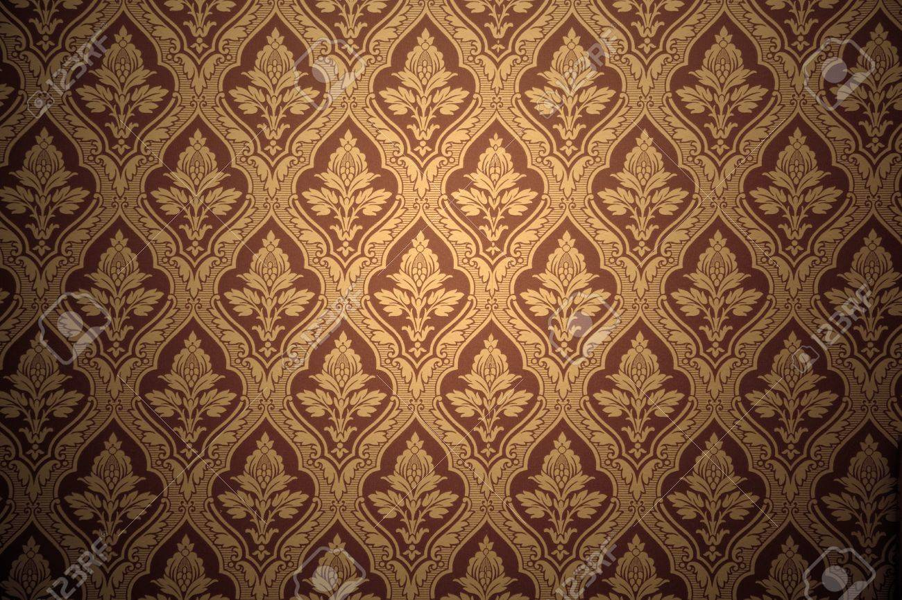 Old Retro Wallpaper In Sepia Grunge Background Stock Photo