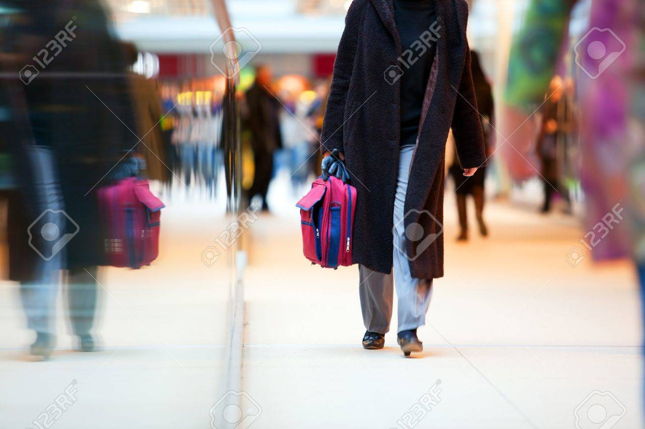 People in rush in a modern shopping mall. Close up and reflection of a woman walking Stock Photo - 11696673