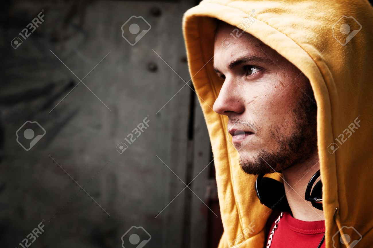 Young man portrait in hooded sweatshirt / jumper on grunge graffiti wall Stock Photo - 14446358