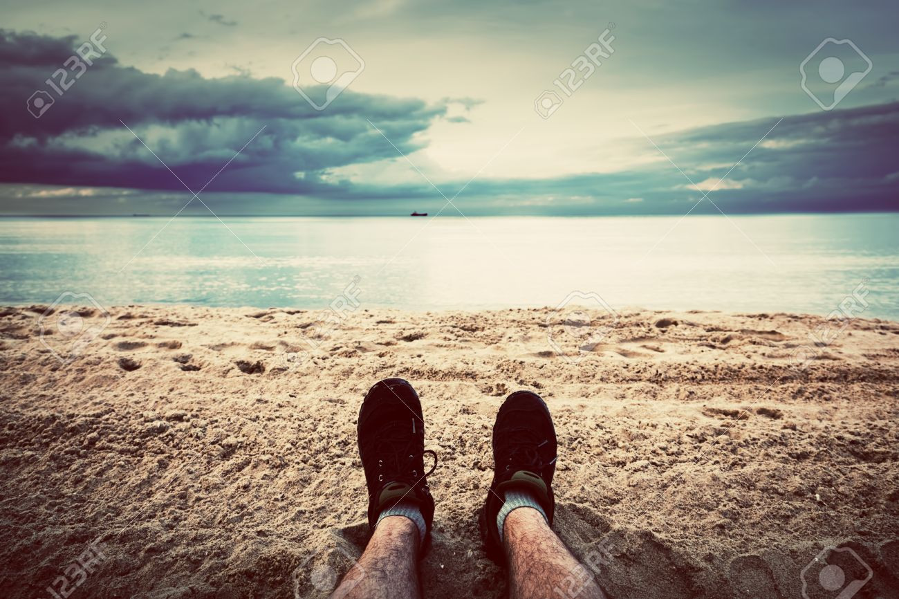 First person perspective of man legs on the autumn beach Vintage, retro  style Stock Photo
