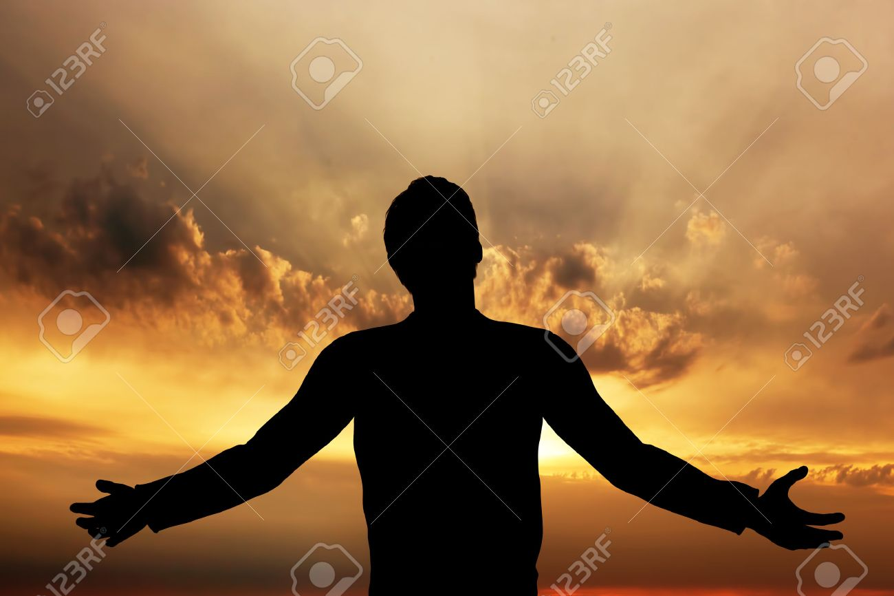 Man praying, meditating in harmony and peace at sunset  Religion,