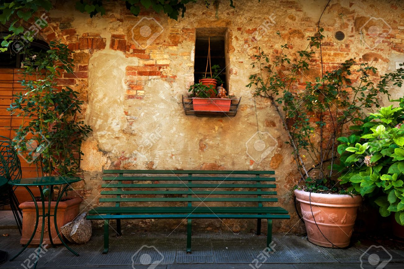 Retro Bench Outside Old Italian House In A Small Town Of Pienza, Italy.  Plants