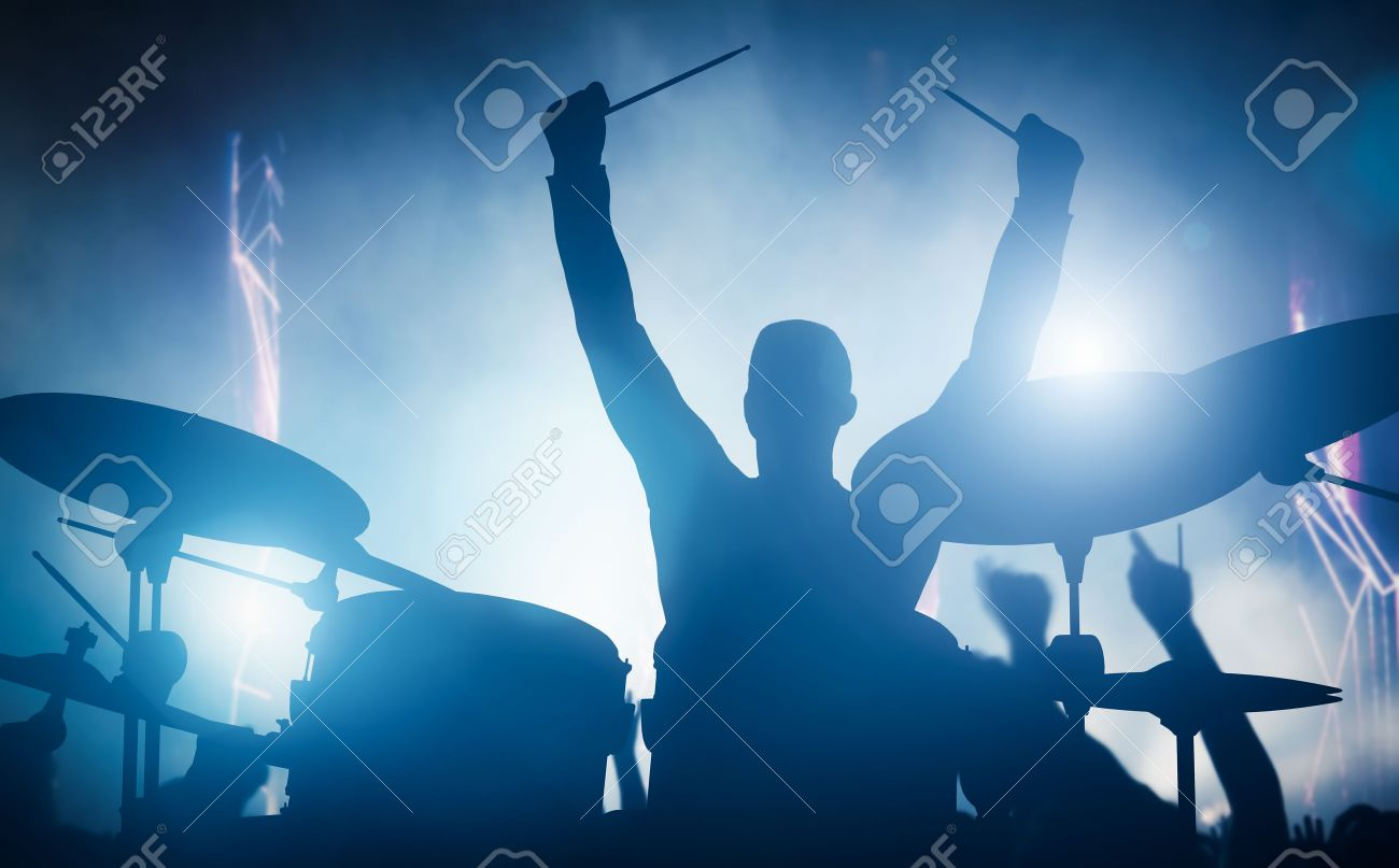 Drummer playing on drums on music concert. Club lights, artist show. Stock Photo - 50883385