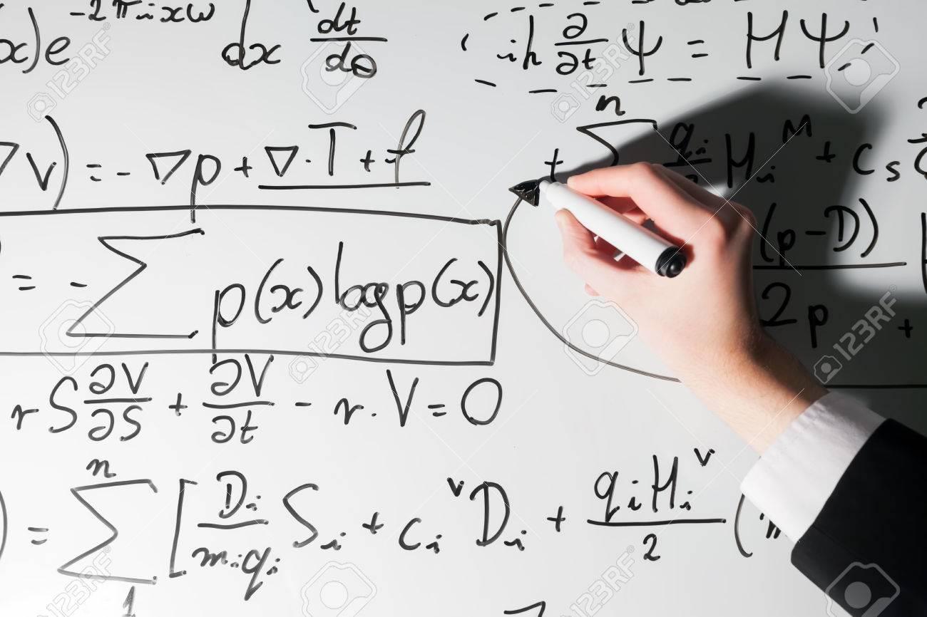Man Writing Complex Math Formulas On Whiteboard Mathematics Stock