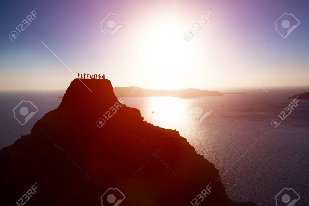 Happy group of people, friends, family on the top of the mountain over ocean celebrating life, success. Children, parents, seniors. Conceptual Stock Photo - 50832276