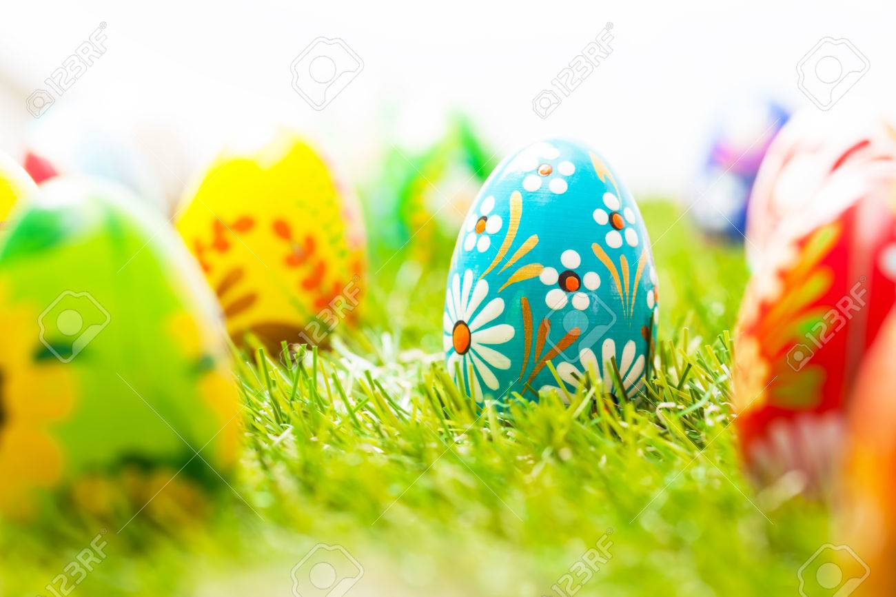 Colorful Hand Painted Easter Eggs In Grass Spring Theme White