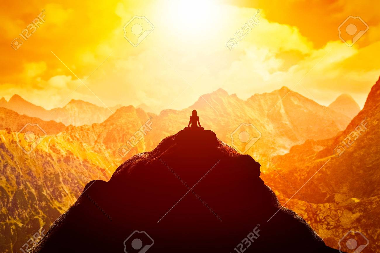 Woman meditating in sitting yoga position on the top of a mountains above clouds at sunset. Zen, meditation, peace - 54942287