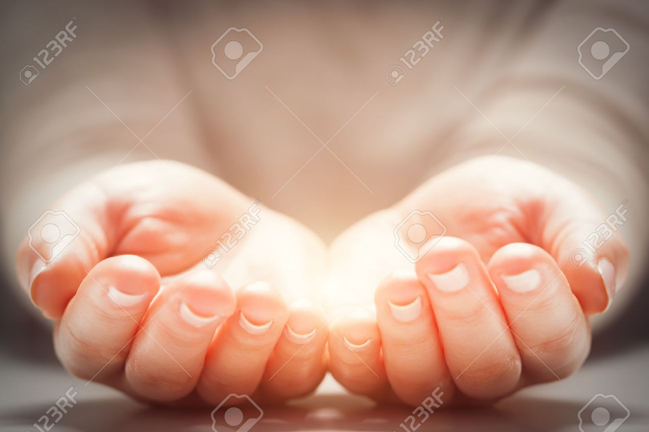 Light in woman's hands. Concepts of sharing, giving, offering, new life - 56766617
