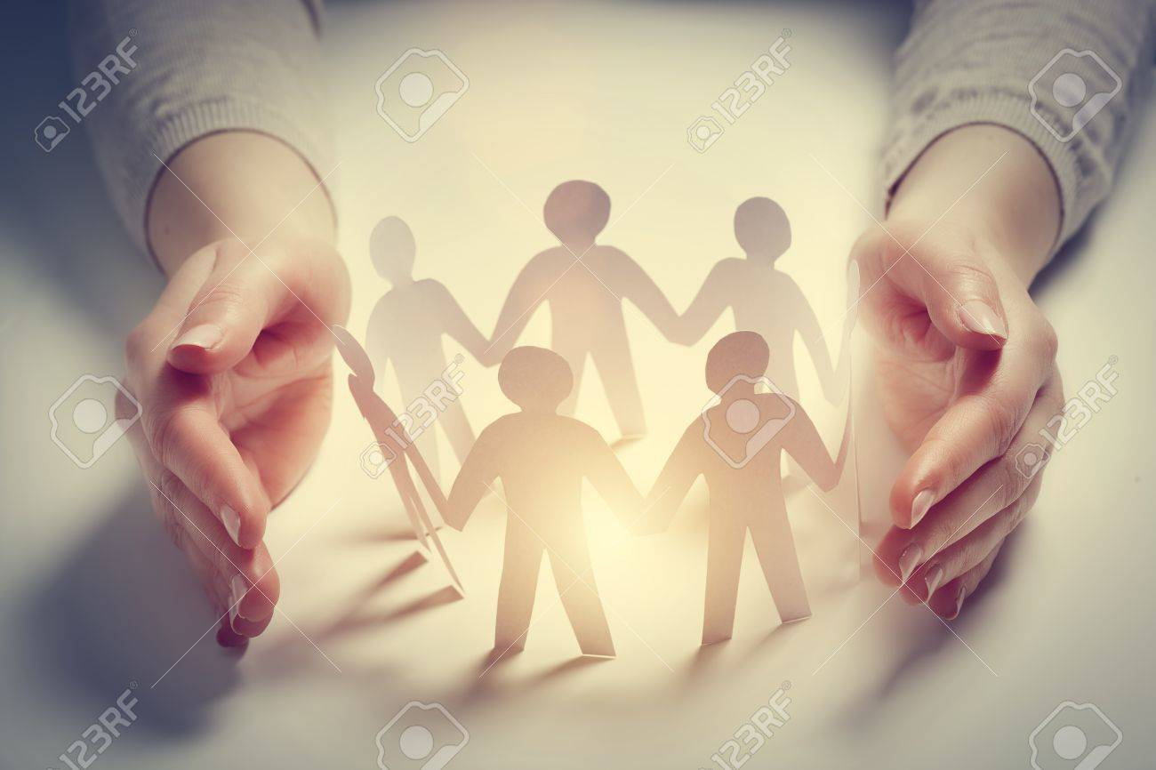 Paper people surrounded by hands in gesture of protection. Concept of insurance, social protection and support. Standard-Bild - 56766729
