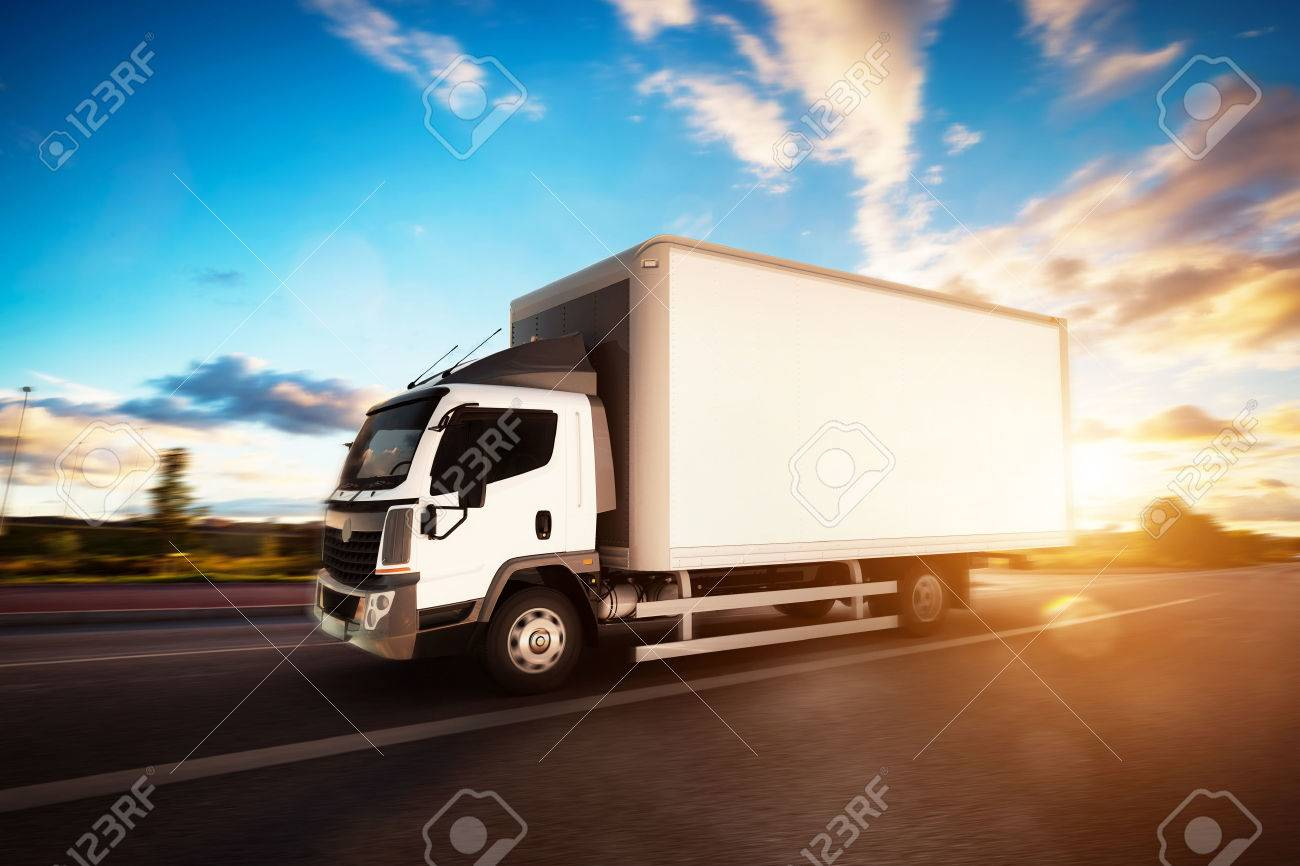 Commercial cargo delivery truck with blank white trailer driving on highway. Generic, brandless vehicle design. 3D rendering Standard-Bild - 64703052
