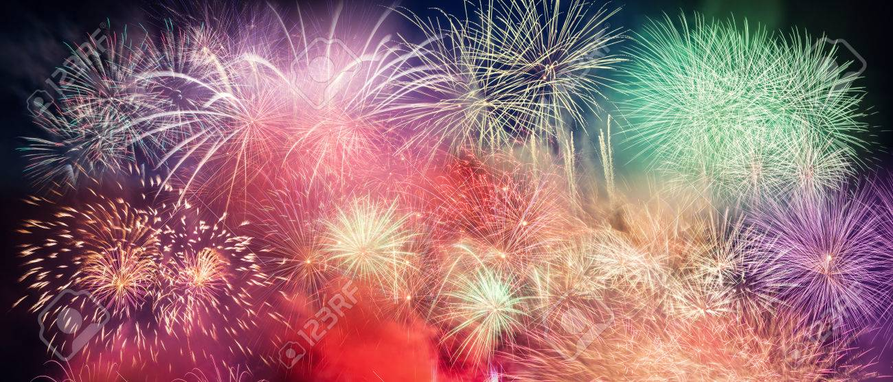 spectacular fireworks show light up the sky new year celebration panoramic background stock photo