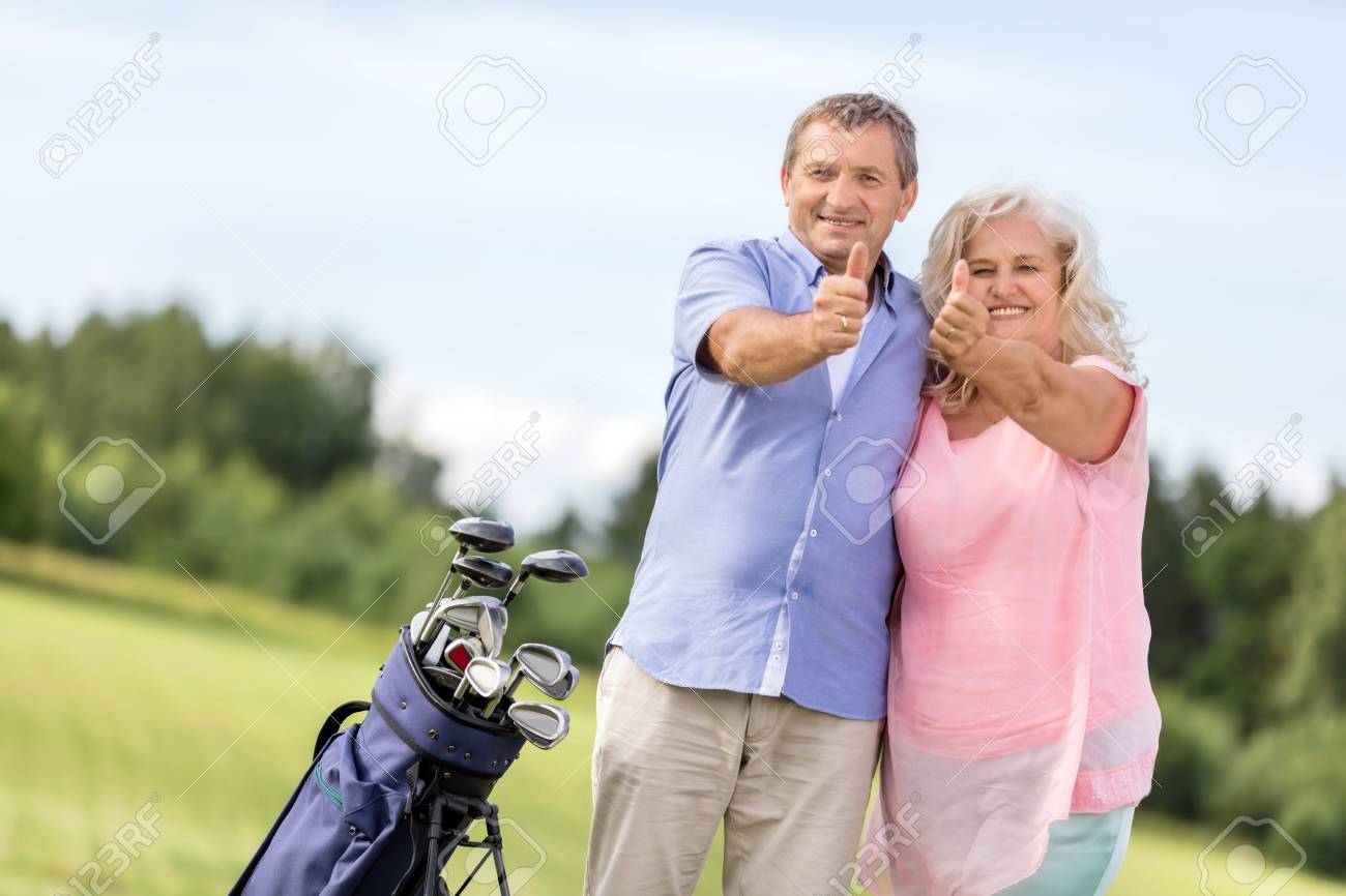 stunning Couple Hobbies Part - 12: Senior couple showing OK sign on a golf course. Retirement hobbies. Stock  Photo -