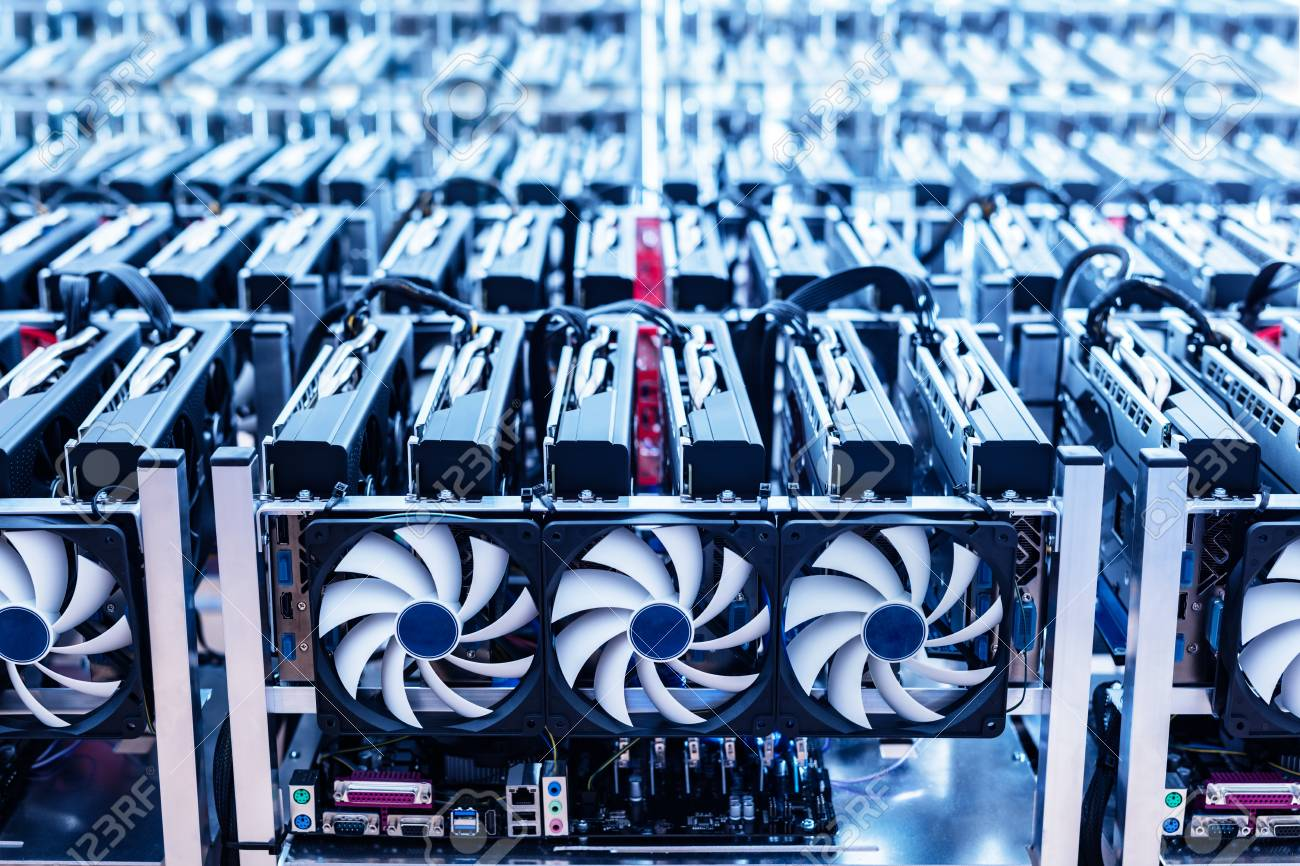 Bitcoin mining farm. IT hardware. Electronic devices with fans. Cryptocurrency miners. - 91747666