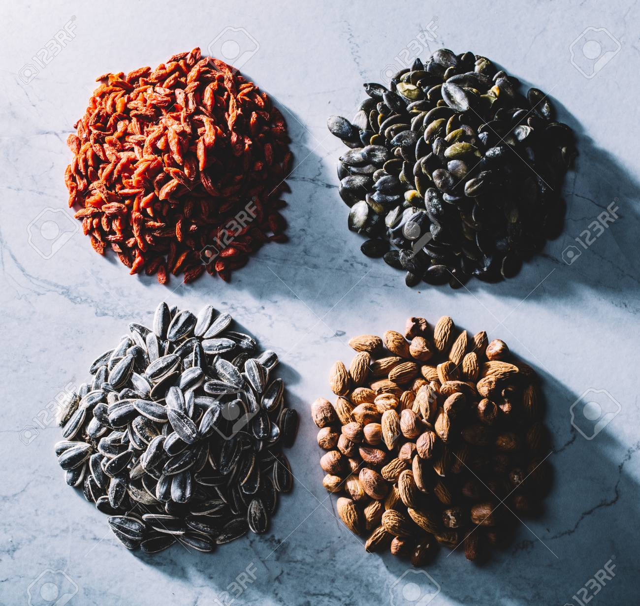Four Piles Of Goji Berries Pumpkin Seeds Sunflower Seeds