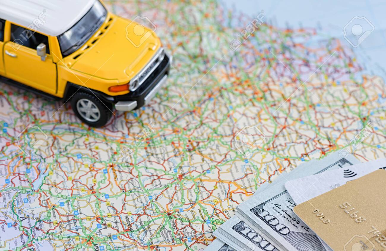 Model SUV on the map. There is money and a credit card. Travel concept. - 149311416