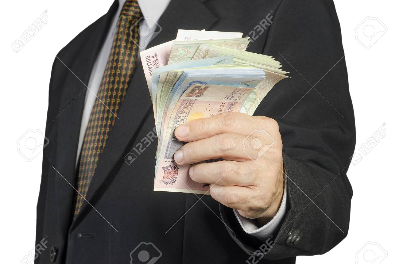 businessman showing packs of international bank note Stock Photo - 24896230