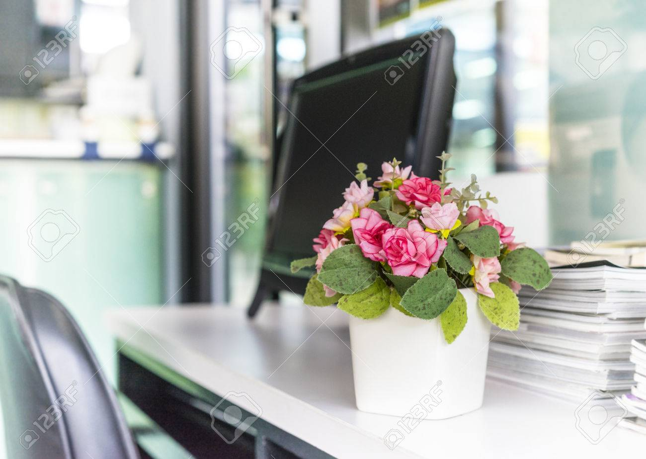 artificial flower on the office desk depth of field stock photo
