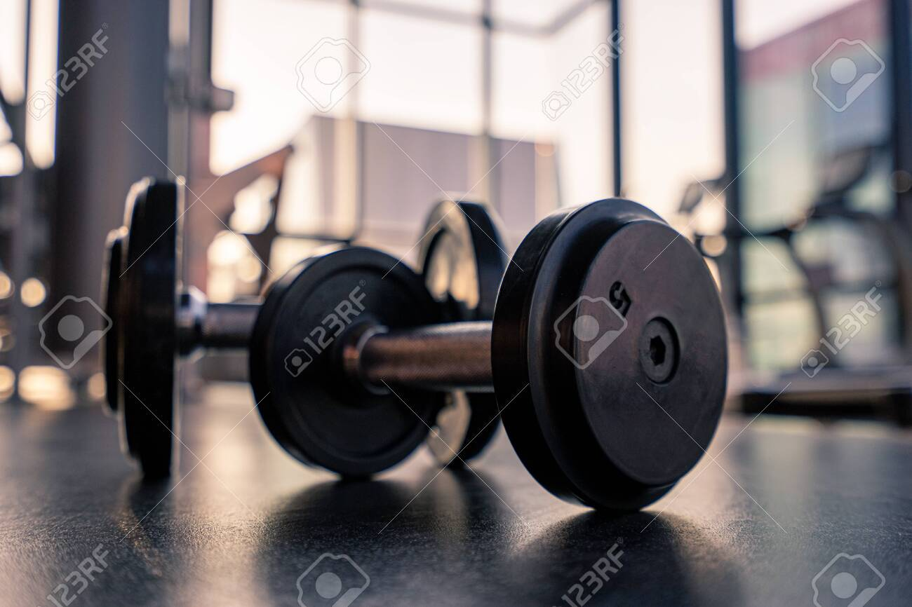 Dumbbell on the floor in luxury clubhouse wait for exercise in the morning - 130674205