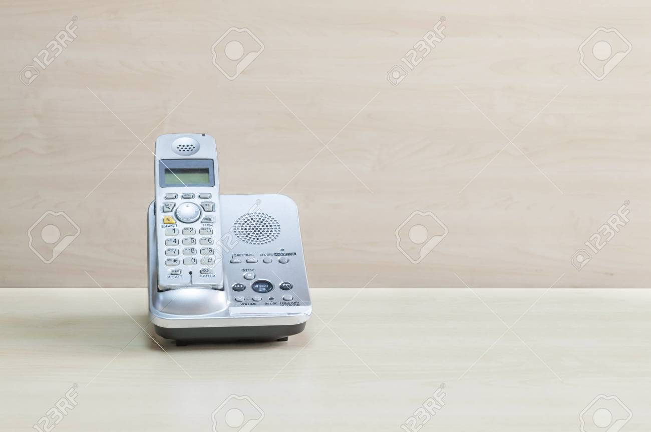 Closeup Gray Phone Office Phone On Blurred Wooden Desk And Stock