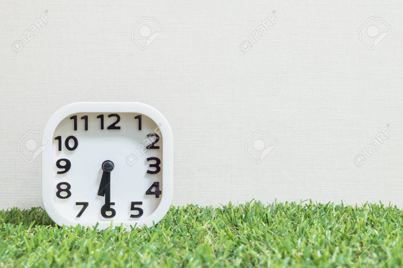 Closeup white clock for decorate show a half past six or 6:30 a.m. on