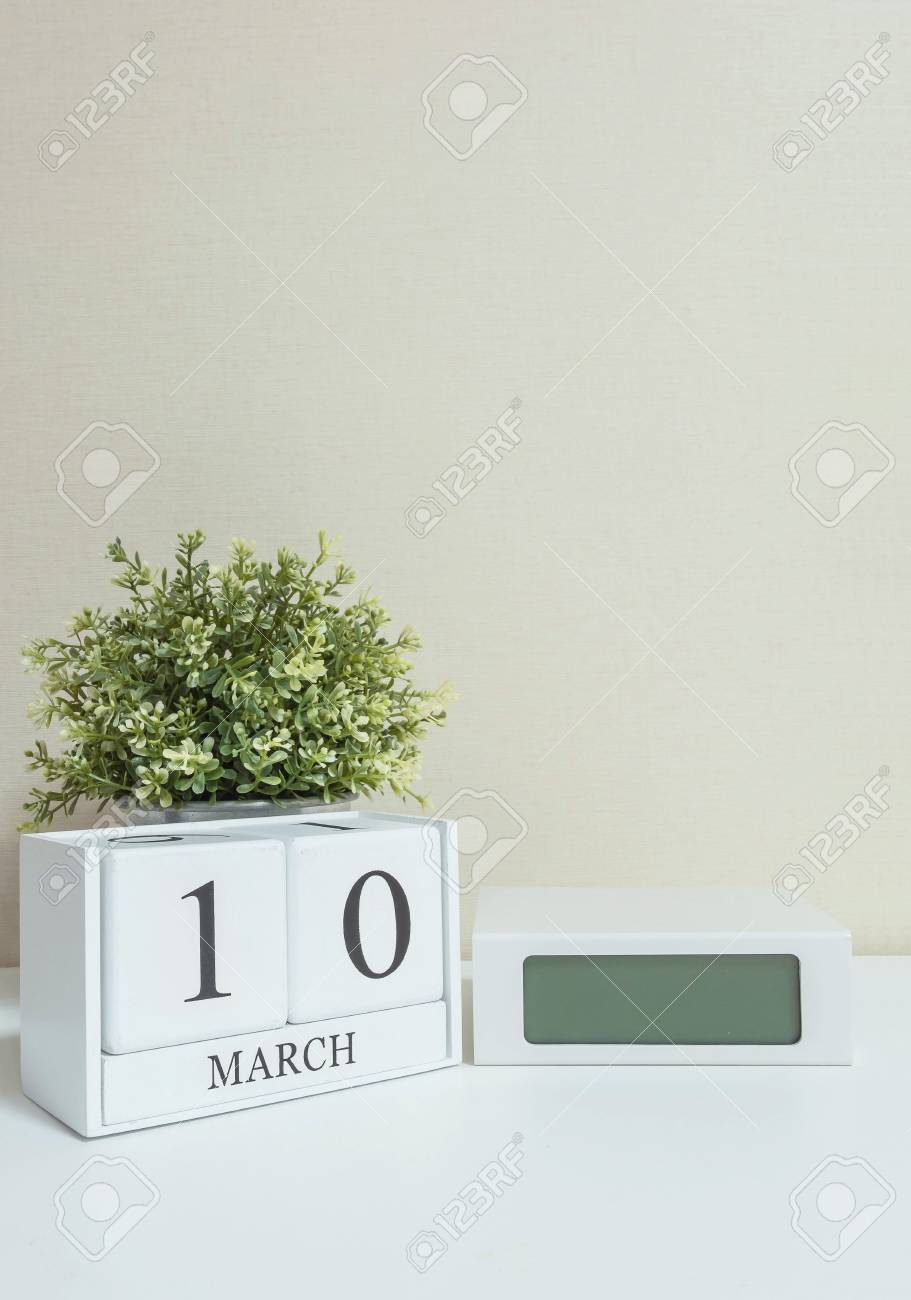 Calendar Clock Wallpaper : White wooden calendar with black 10 march word with clock and
