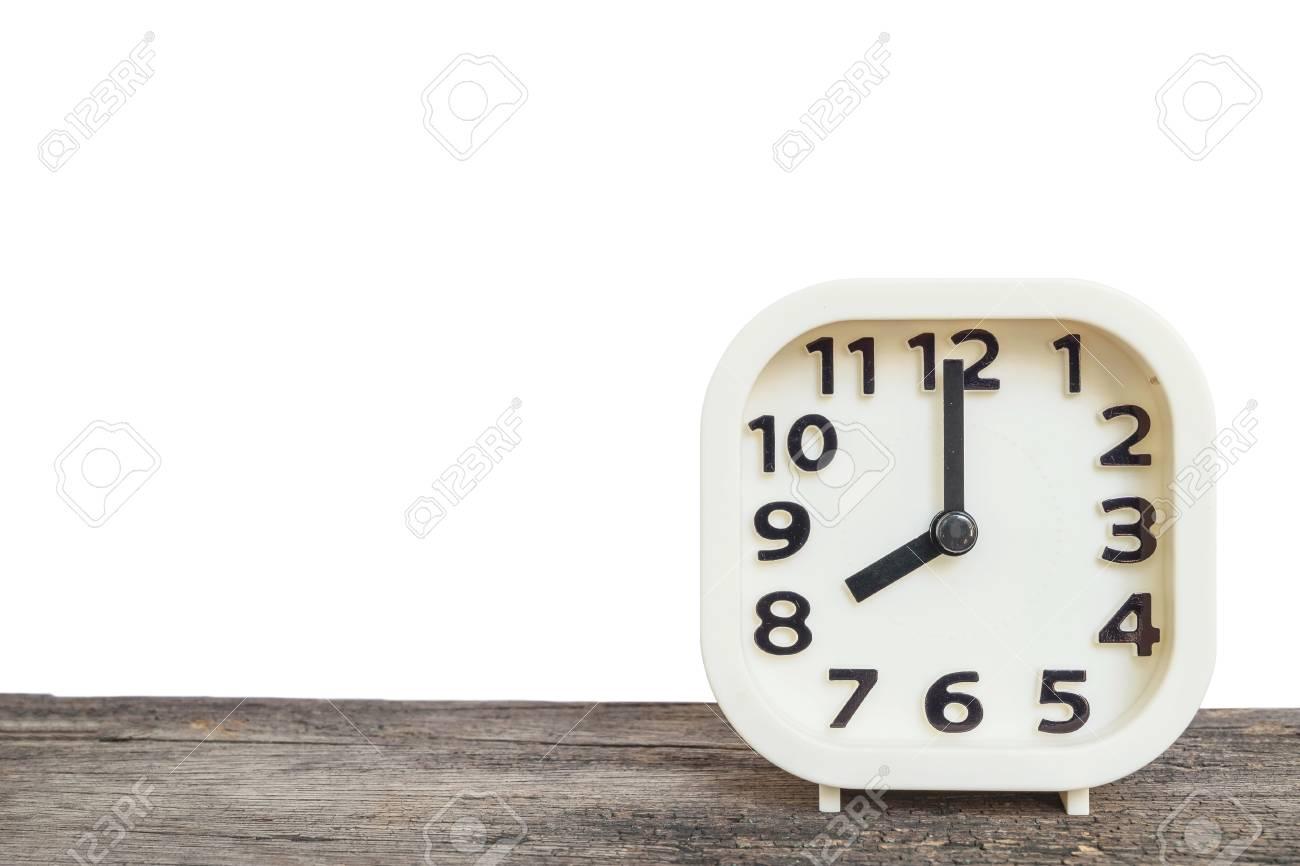 Horloge blanche de closeup pour décorer dans 8 heures sur le vieux
