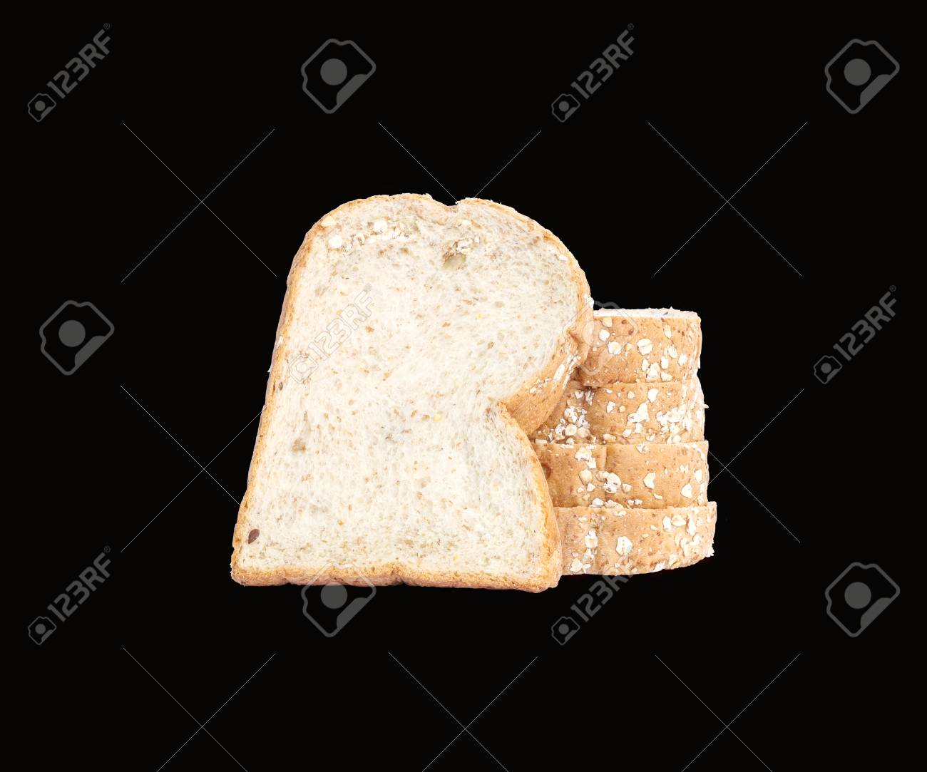 Closeup Pile Of Wheat Bread For Breakfast Isolated On Black Background