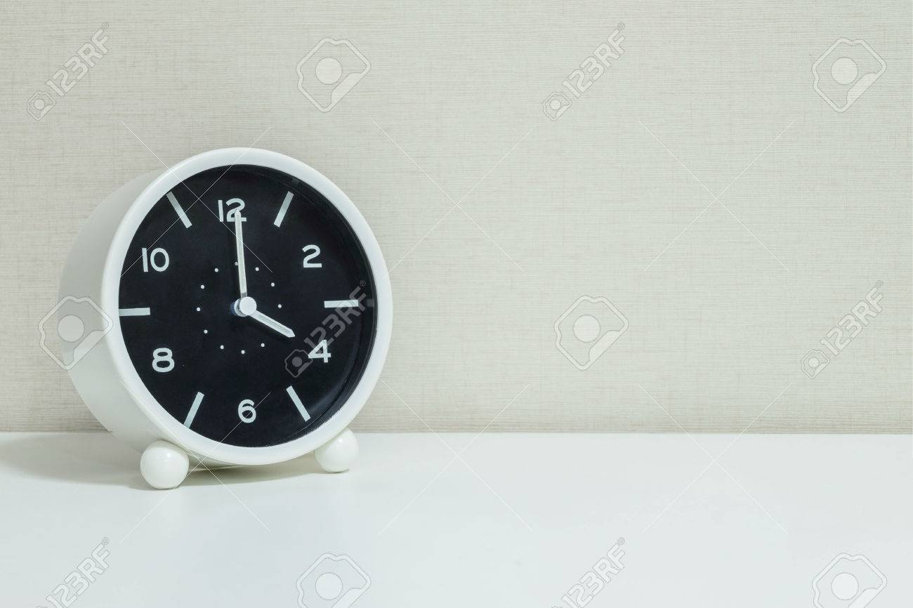 Closeup Black And White Alarm Clock For Decorate In 4 Oclock On Wood
