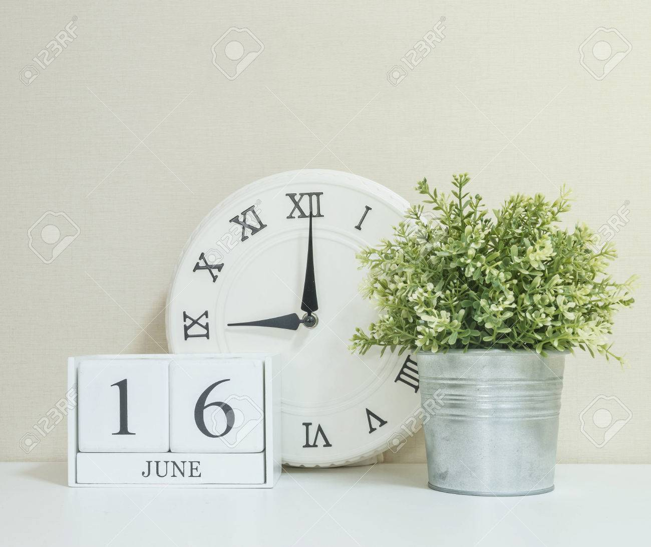 Calendar Clock Wallpaper : White wooden calendar with black 16 june word with clock and.. stock